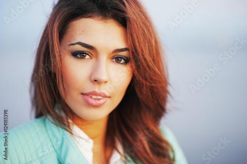 Fotografia  Stunning portrait of a young beautiful girl outdoors closeup.