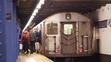 Commuters Board Subway, New York City.