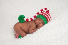 Baby Girl Wearing A Christmas Stocking Cap