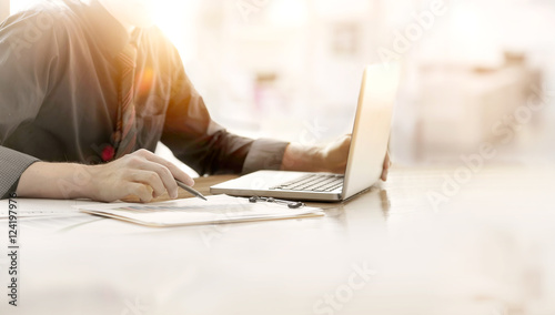 Fotografie, Obraz  Close up of hand of business man working document and laptop in office morning light