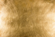 Scratched Industrial Brass Metal Plate Textured Background Pattern With Light Reflections