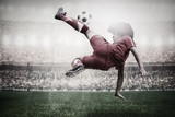 Fototapeta Sport - Soccer or football player in blue and white shooting the ball