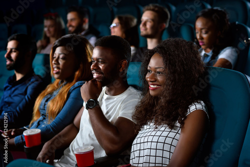 Group of multicultural friends at the movie theatre Slika na platnu