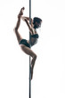 Female pole dancer with body-art on pylon