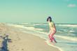 Playful woman having fun on the beach