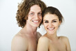 Portrait of young contented couple. Young man and woman embracin