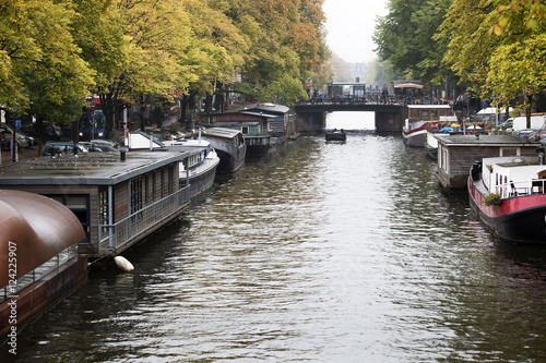 Photo  Houseboats in the canals of Amsterdam