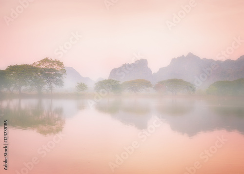 Poster Blanc Amazing watercolor view of foggy morning landscape with trees reflection in lake water. Hpa An, Myanmar (Burma) travel landscapes and destinations