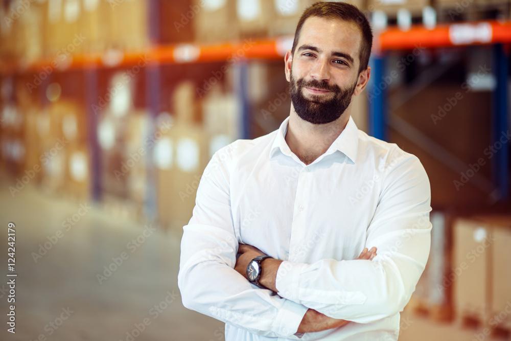 Fototapeta Logistics manager posing in warehouse