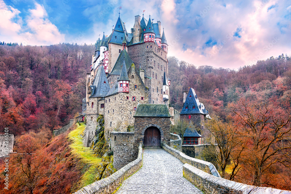 Fototapeta Fairytale castle in autumn landscape