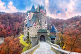 Fairytale castle in autumn landscape