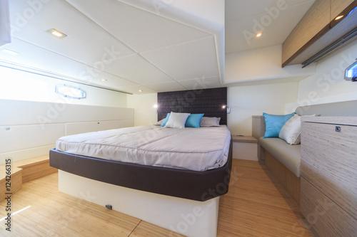 interior of luxury motoryacht, bedroom cabin