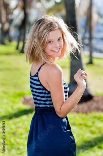 Fotografie, Obraz  Young Woman Playful in Park