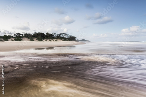 Tallows creek running out into the ocean at a spot known as dolphins at tallows beach after heavy storms;Byron bay new south wales australia