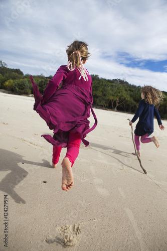 Two girls running on a beach;Gold coast queensland australia