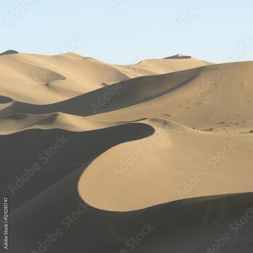Desert landscape of sand slopes and ridges