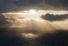 Sunlight Streaming Through The Dark Clouds And Reflecting On The Ocean;County Clare, Ireland