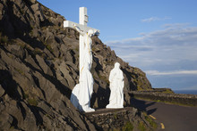 Statue Of Jesus Christ On The Cross With Two Women At The Foot Of The Cross On The Side Of The Road;County Kerry, Ireland