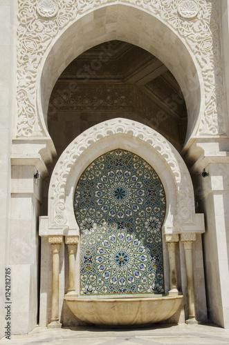 Ornate facade on the hassan ii mosque;Casablanca morocco Poster