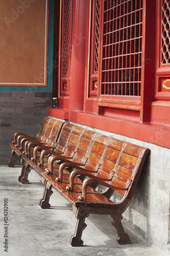 Foto op Plexiglas Wand Wooden seating against a concrete and red wall;Forbidden city beijing china