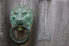Brass Lion Door Knocker On A Wooden Door;Howick Northumberland England