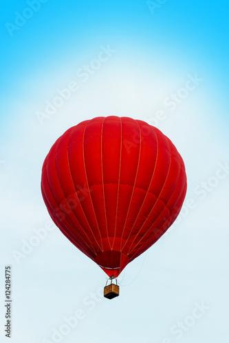 In de dag Ballon Red hot air ballon in the blue sky