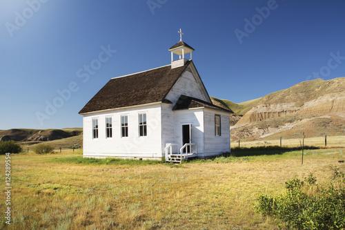 Bright white little church in the badlands; Dorothy, Alberta, Canada