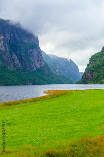 Foto op Aluminium Oceanië Cloudy rainy mountains and fjord in Norway,
