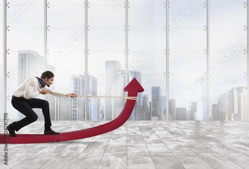 Businessman changes statistics Wallpaper Mural