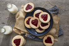 Strawberry Jam, Heart Shaped Linzer Biscuits On A Plate With Mil