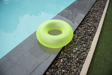 Green Colorful Ring Pool For Kid Near Swimming Pool Side. Toy : Beautiful Green Pool Float, Pool Ring In Cool Blue Refreshing.