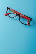 Pair Of Red Plastic-rimmed Eye...