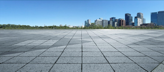 Panel Szklany Empty marble floor with cityscape and skyline in clear blue sky