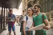 canvas print picture - Happy tourists exploring city