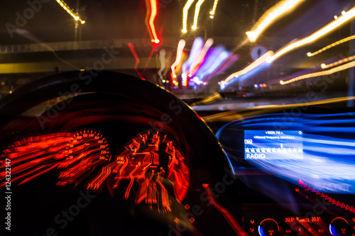 Fototapeta drunk driver goes at night. view from inside. abstract