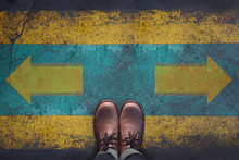 Top View, Male With Leather Shoes, Arrow Sign For Left 0r Right On Grunge Dirty Concrete Floor, Making Decision At The Crossroad