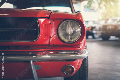Poster  Close up headlight of red Retro classic car