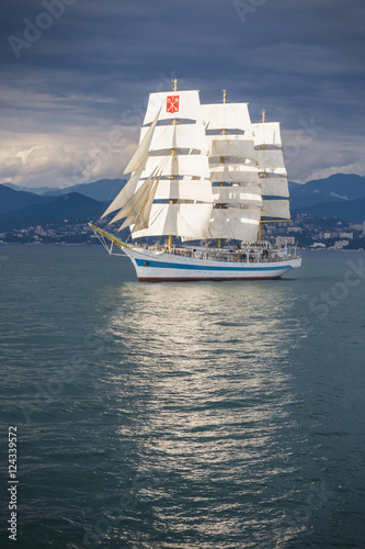 Beautiful sailboat in the background of mountains © astreluk