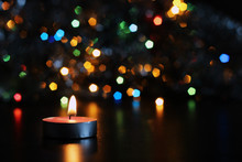 New Year Candle On Blurred Background