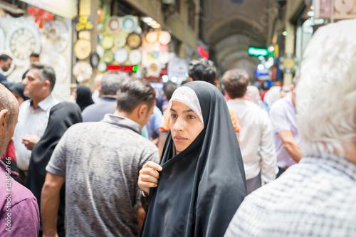 Beautiful Muslim woman spending time on traditional Iranian baza Canvas Print