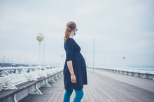 Young Pregnant Woman On The Pier