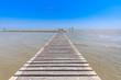 old wood bridge pier with nobody against beautiful sky