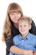 Smiling happy Caucasian mother hugging her son, portrait isolated on white background