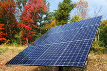 Solar Panel With Colorful Autumn Trees