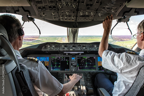 Pilot and copilot in commercial plane Tablou Canvas