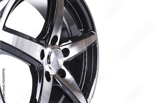 Photo  Part of car aloy wheel, rim isolated on white
