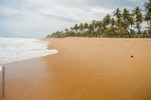 Foto auf Acrylglas Tropical strand Tropical Azuretti beach on the Atlantic ocean coast in Grand Bassam, stock image. Ivory Coast, Africa. April 2013.