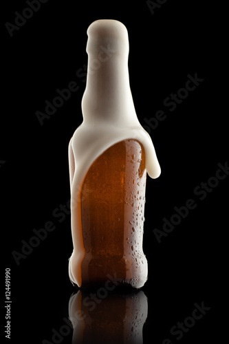 Suds Getting Out of an Overflowing Beer Bottle Canvas Print