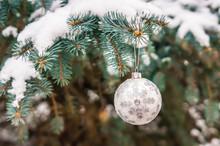 Silver Christmas Ball On A Sno...