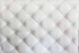 Fototapeta Bedroom - quilted leather sofa covering closeup